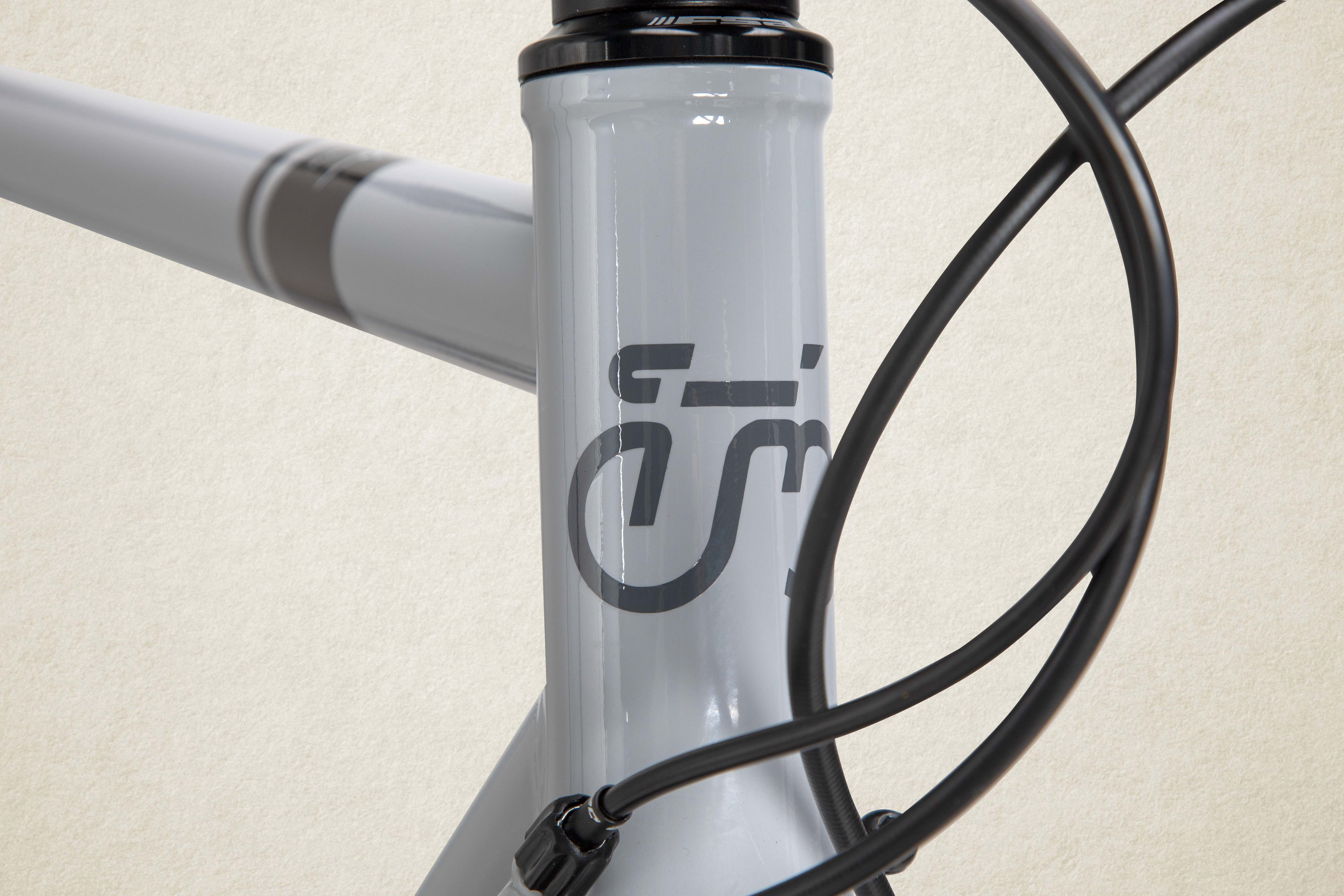 The modern heritage logo on the head tube of the steel Hageland.